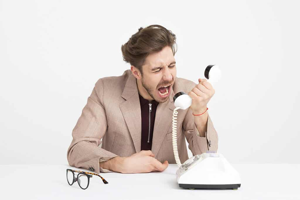 Office worker, Handsome young man shouting into telephone, Spiritual Warfare In The Workplace: A Helpful Guide