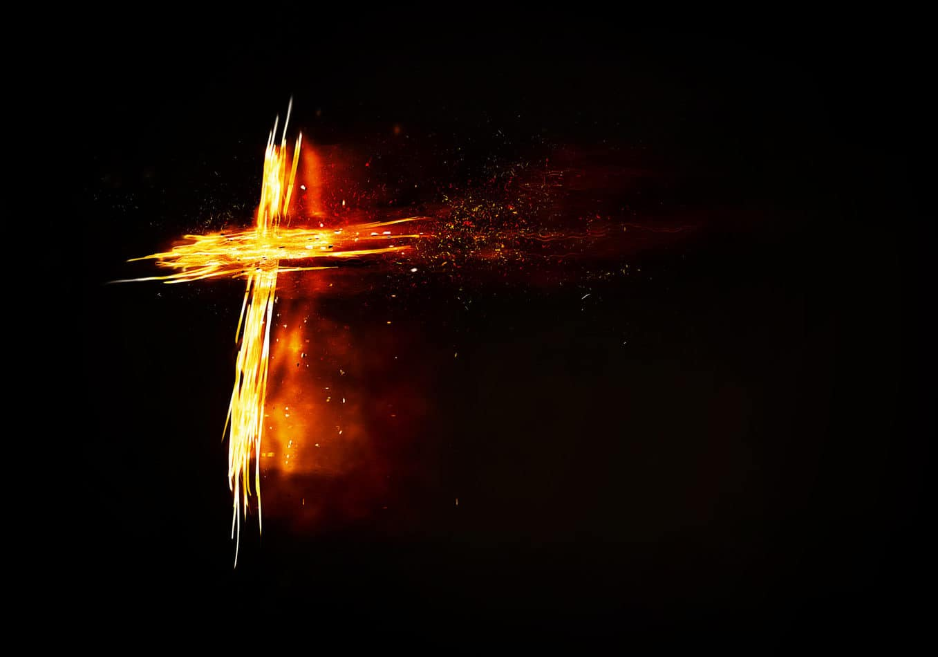A glowing and burning cross on a black background